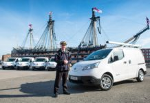 Commodore Jeremy Rigby, Naval Base Commander, is pictured beside the electric vans, e-NV200 Combis