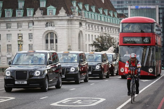 London electric taxis and a Boris Bus Routemaster