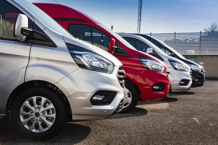 Ford Transit Connect vans in line