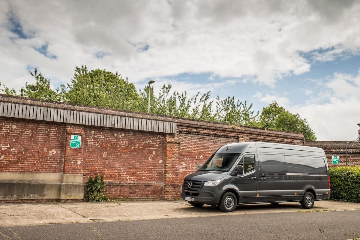 Mercedes-Benz Sprinter alongside a wall | The Van Expert